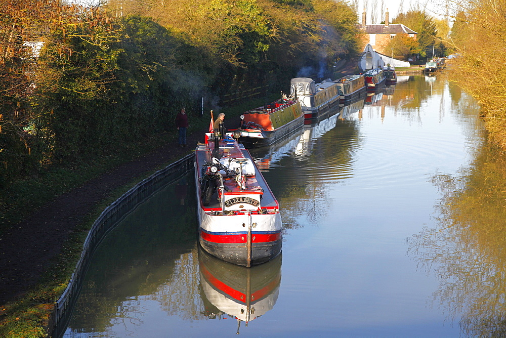 Narrow boats and reflections on the Grand Union Canal, Northamptonshire, England, United Kingdom, Europe