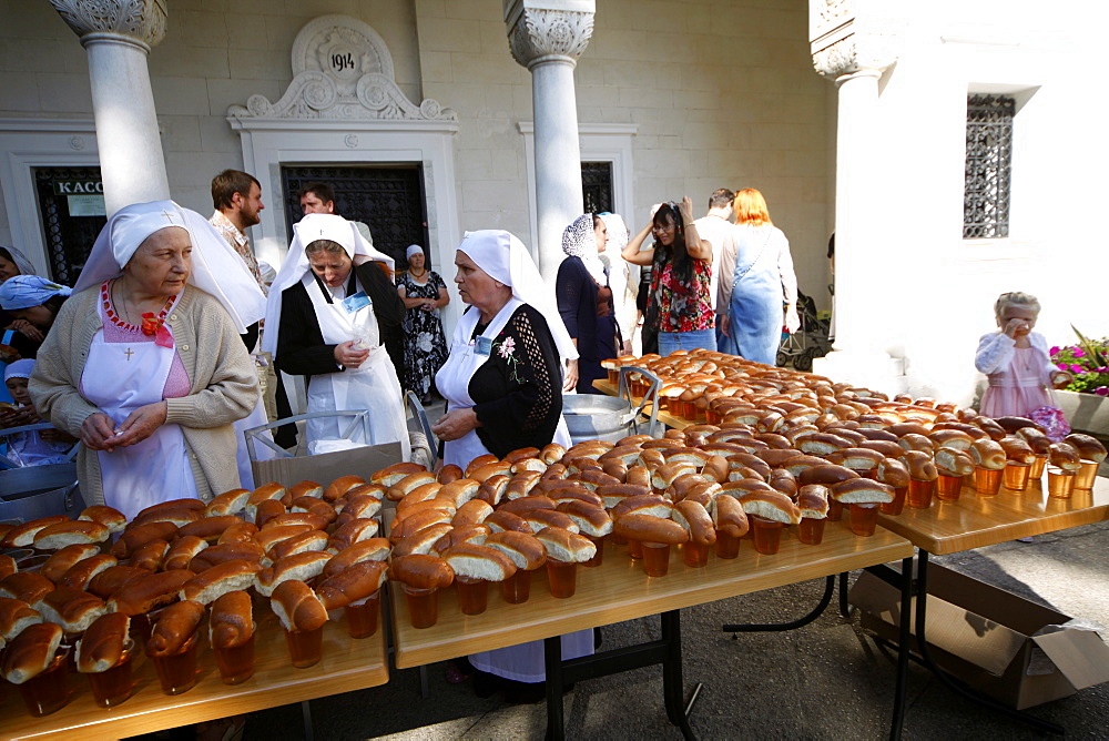 Nuns give out bread at Romanov Chapel of the Holy and Life-giving Cross, Yalta, Crimea, Ukraine, Europe