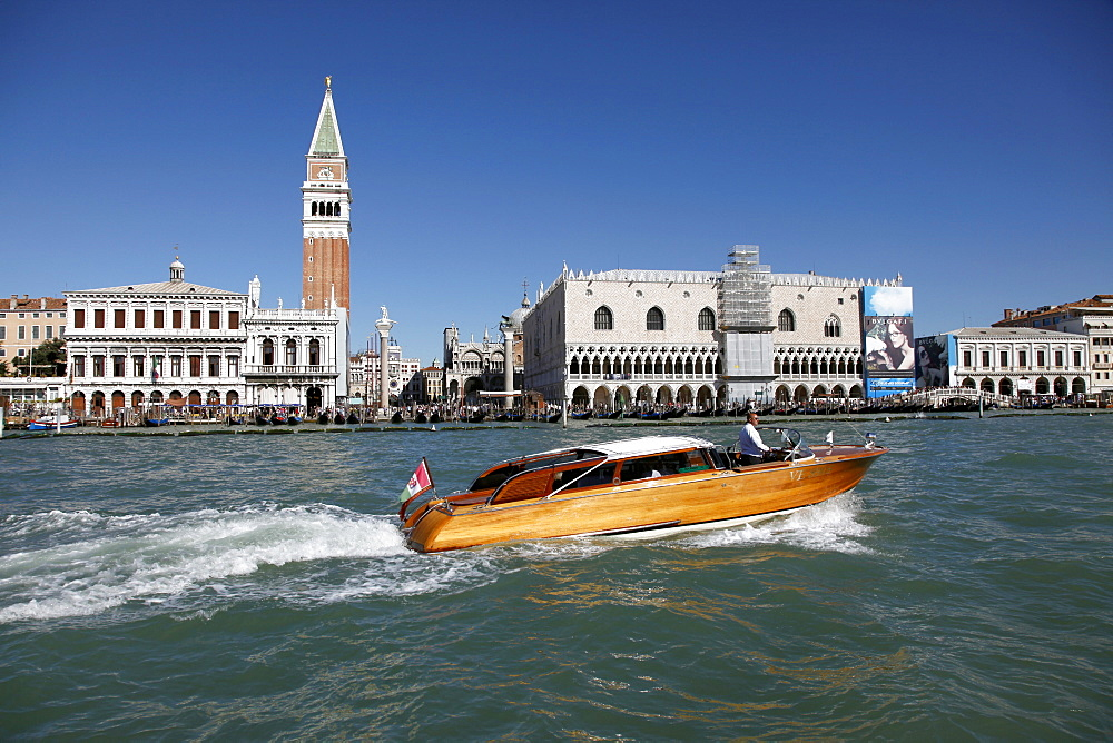 Speed boat, Campanile of San Marco, Doge's Palace from the Dogana, Venice, UNESCO World Heritage Site, Veneto, Italy, Europe - 1130-1459