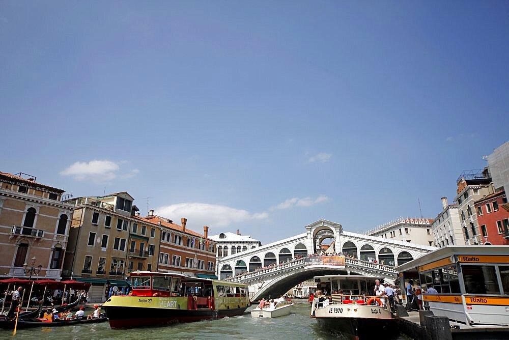 Rialto Bridge and passenger ferries, Venice, UNESCO World Heritage Site, Veneto, Italy, Europe