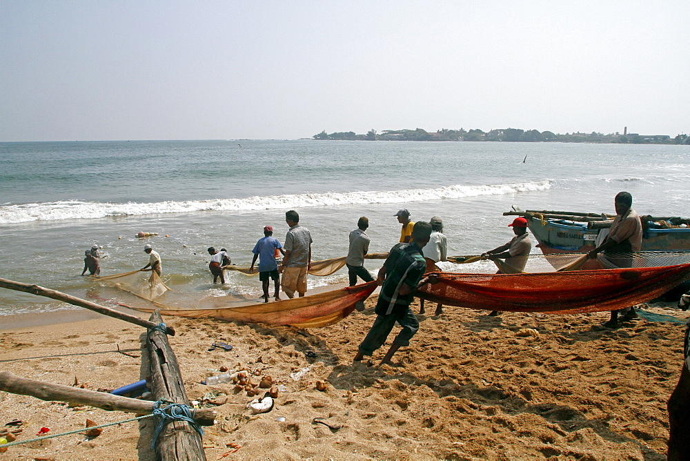 Fishermen pull nets from the Indian Ocean, Galle, Sri Lanka, Asia