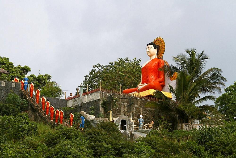 Budhha statue and statues depicting the visit of Arahat Mahinda, Unawatuna, Sri Lanka, Asia