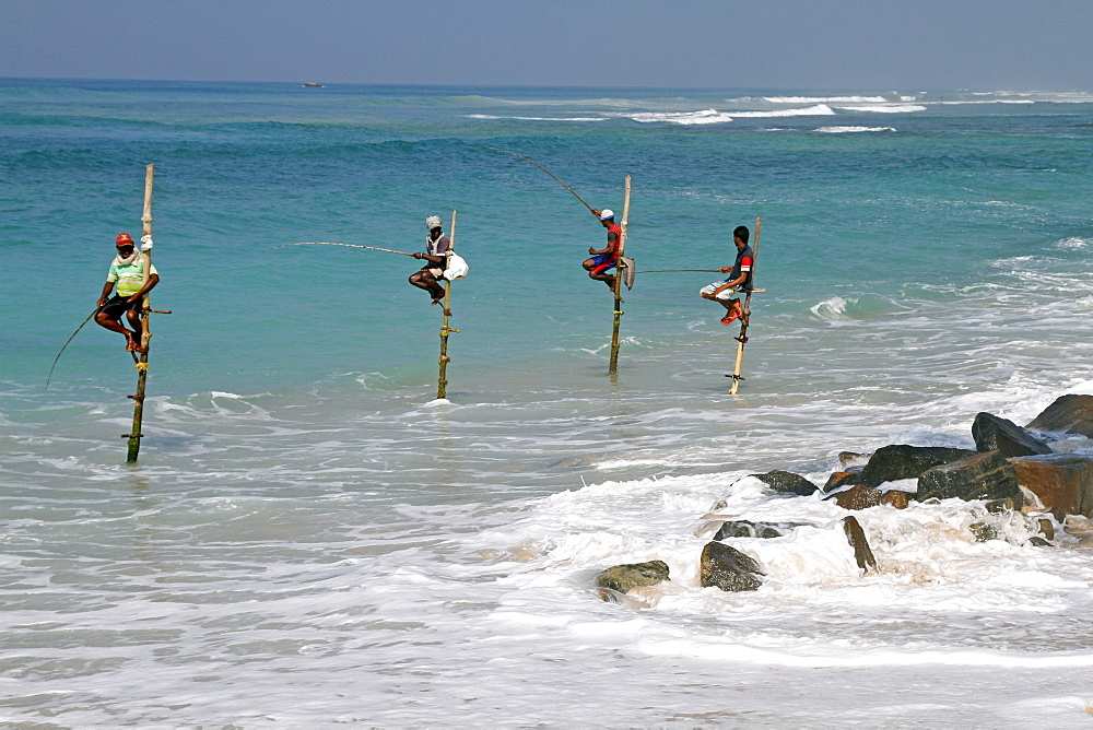 Stilt fishermen and Indian Ocean, Midigama, Sri Lanka, Asia