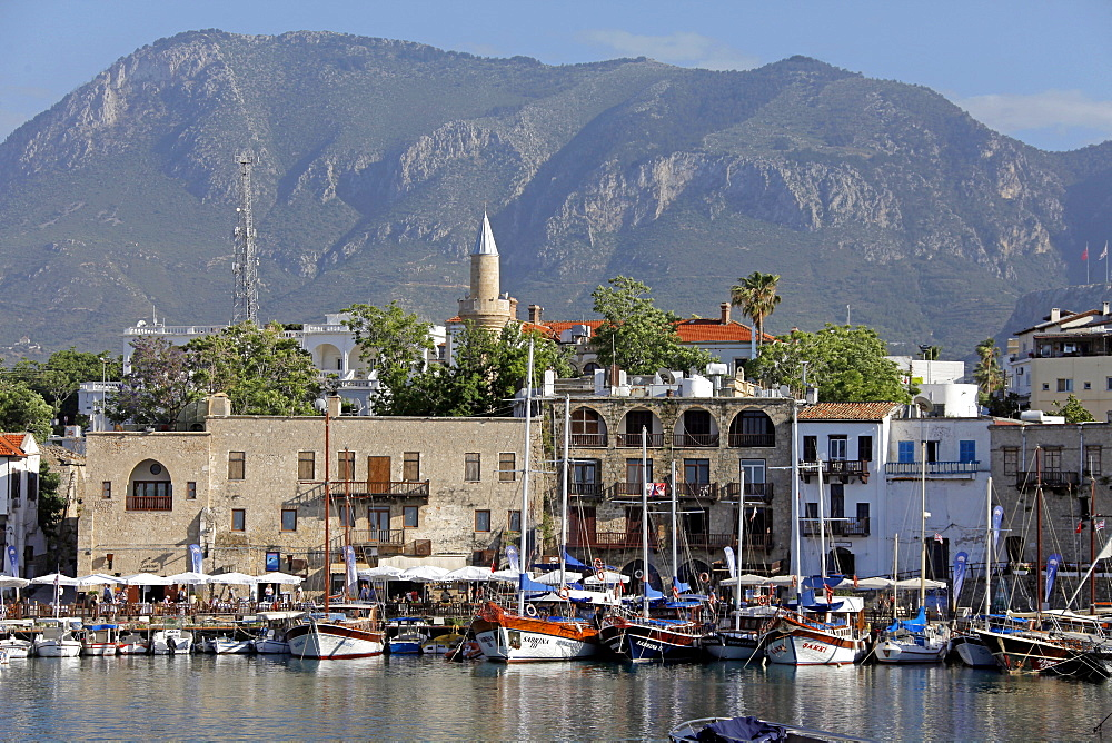 Boats in harbour and minaret, Kyrenia, Northern Cyprus, Mediterranean, Europe