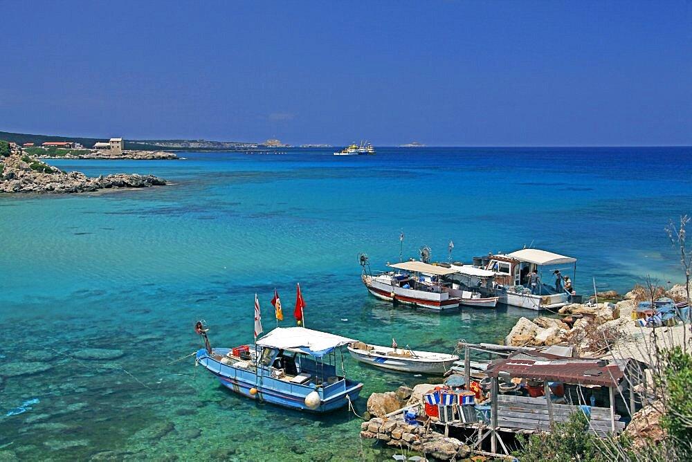 Fishing boats and blue water, Karpas Peninsula, Northern Cyprus, Mediterranean, Europe