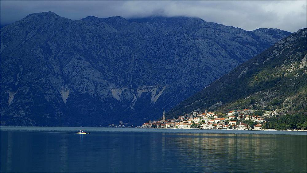Canoeing on kotor bay,perast town & mountain range, kotor bay, Montenegro