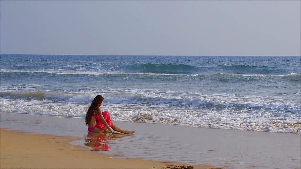 Model Sat In Indian Ocean Surf, Bentota, Sri Lanka - 1130-2346