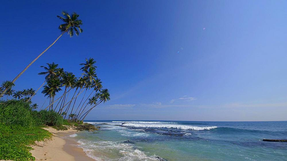 Rocky Indian Ocean Bay & Coconut Palms, Talpe, Sri Lanka