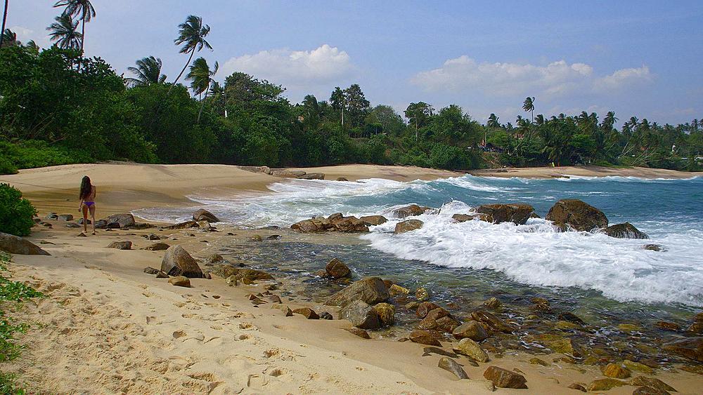 Woman Walks Along Indian Ocean Beach, Tangalle, Sri Lanka