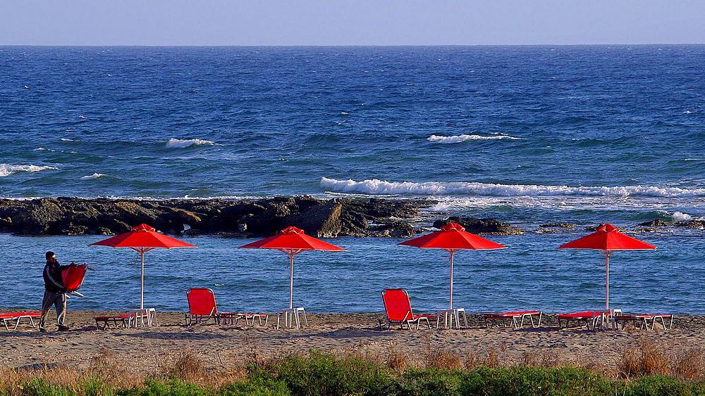 Pulling Down Red Parasols On Mediterranean Sea
