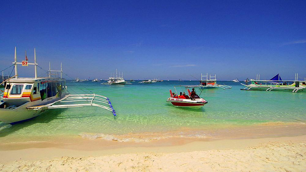 Speed boat arrives at shore, white beach, Boracay Island, Philippines