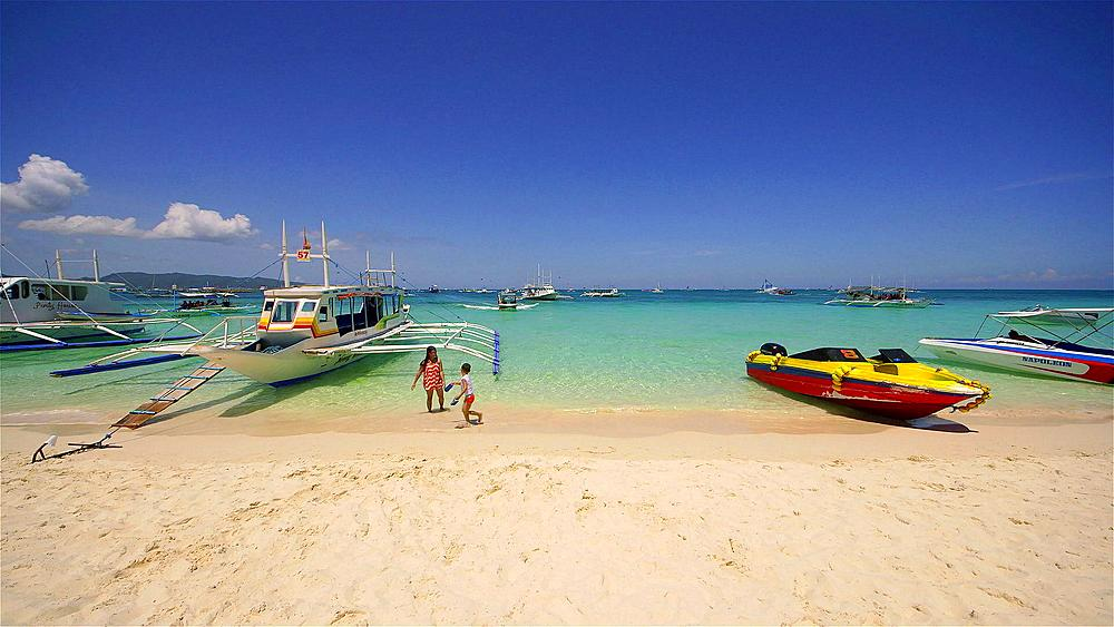 Jukung tourist boat & speed boats, white beach, Boracay Island, Philippines