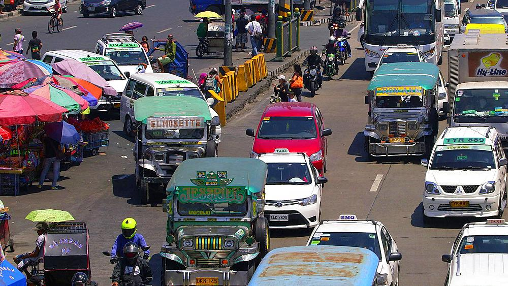 Jeef buses join traffic jam, Baclaran, Manila, Philippines