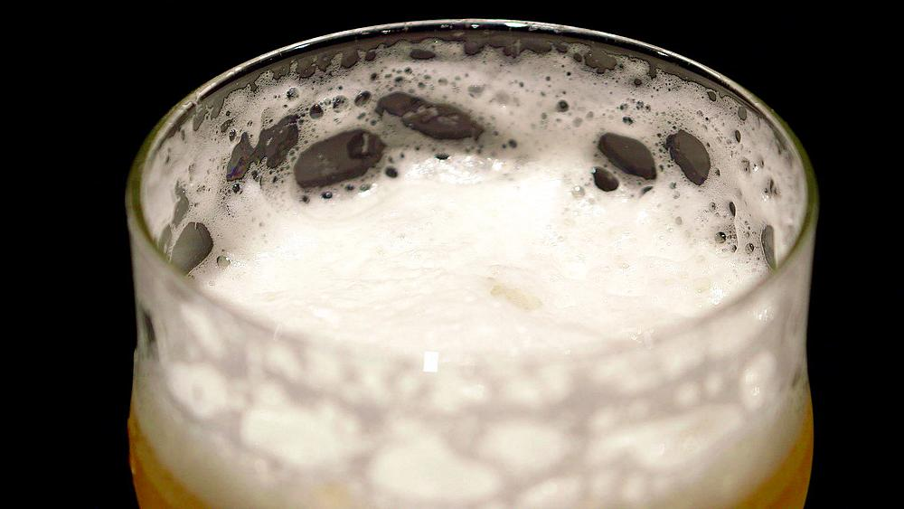 Receding Froth On Pint Of Lager Beer, Scarborough, England