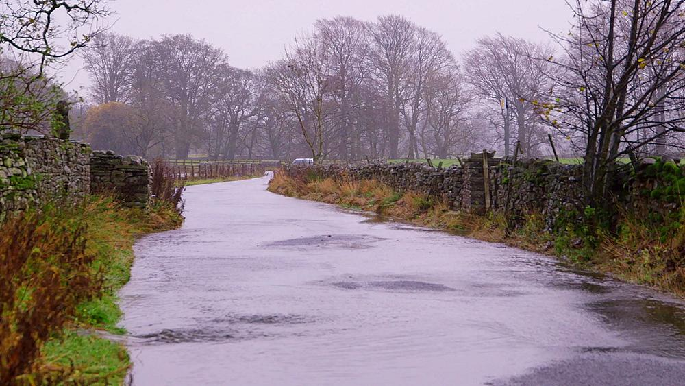 Mercedes Benz car drives through flood, appersett, hawes, North Yorkshire, England