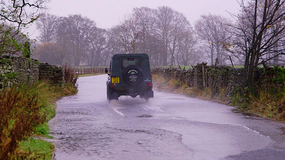 Land rover drives through flood, Appersett, Hawes, North Yorkshire, England