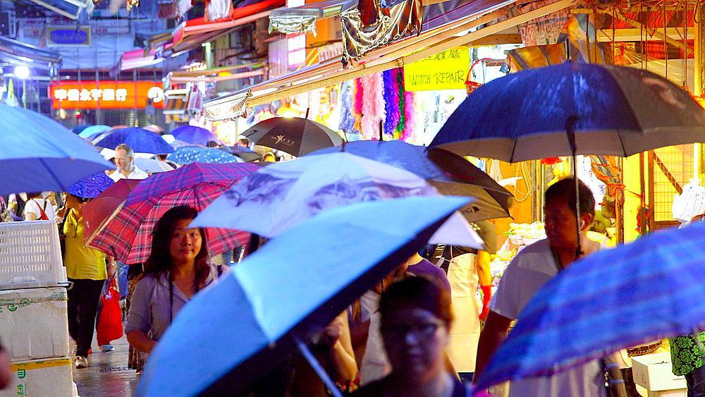 Shoppers With Umbrellas At Street Market, Wan Chai, Hong Kong, China