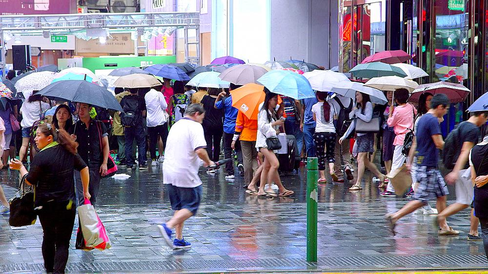 Crowd Of Pedestrians With Umbrellas, Tsim Sha Tsui, Kowloon, Hong Kong, China