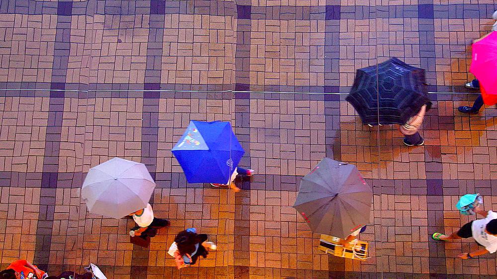 Mirrored Reflection Looking Down On Pedestrians With Umbrella, Tsim Sha Tsui, Kowloon, Hong Kong, China