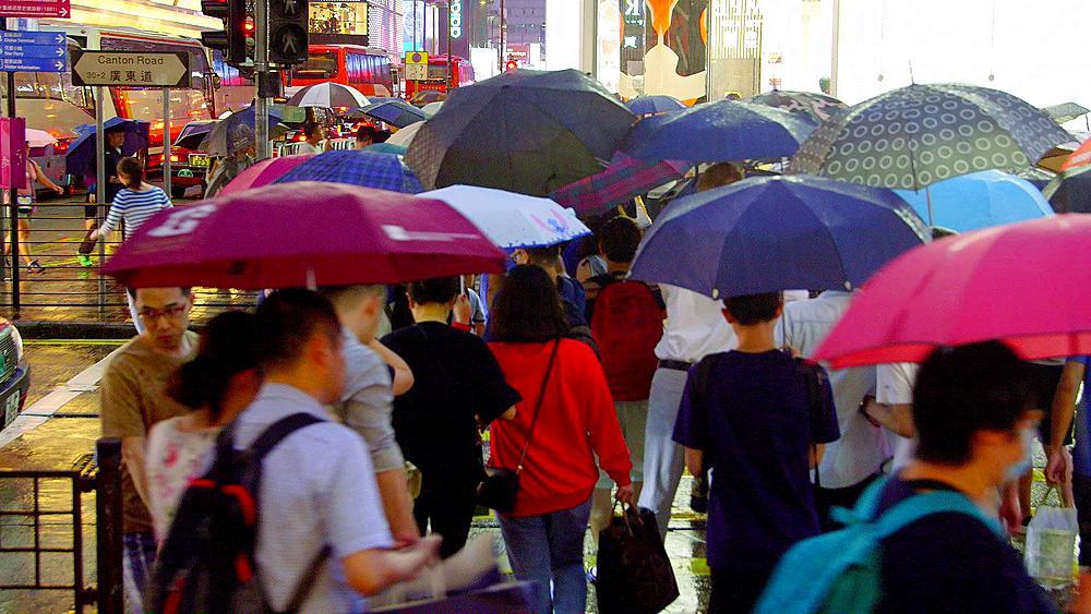 Pedestrians Crossing Canton Road With Umbrellas, Tsim Sha Tsui, Kowloon, Hong Kong, China