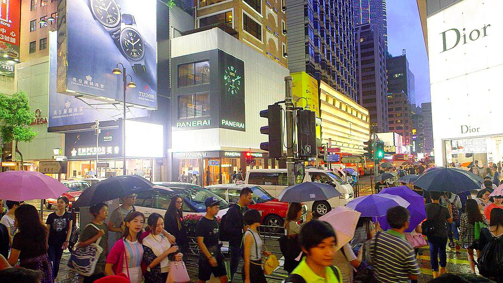 Traffic & Pedestrians With Umbrellas On Canton Road, Tsim Sha Tsui, Kowloon, Hong Kong, China