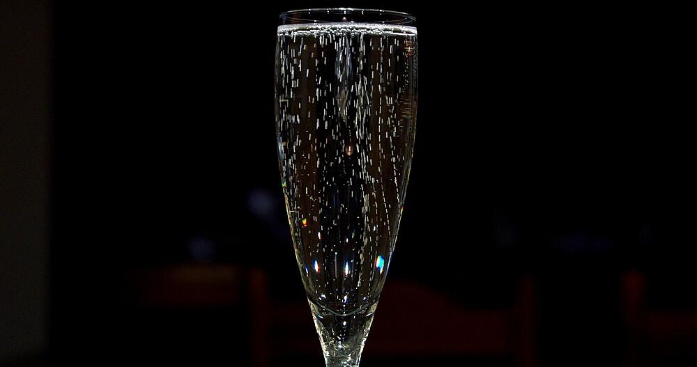 Sparkling wine in glass, kitchen activities