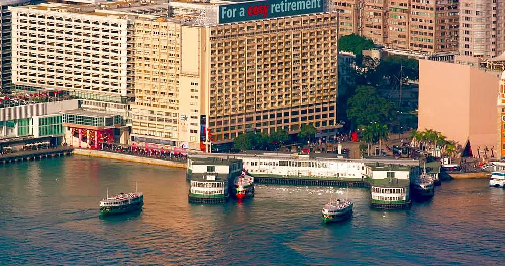 Two star ferries docking at terminal, Tsim Sha Tsui, Hong Kong, China