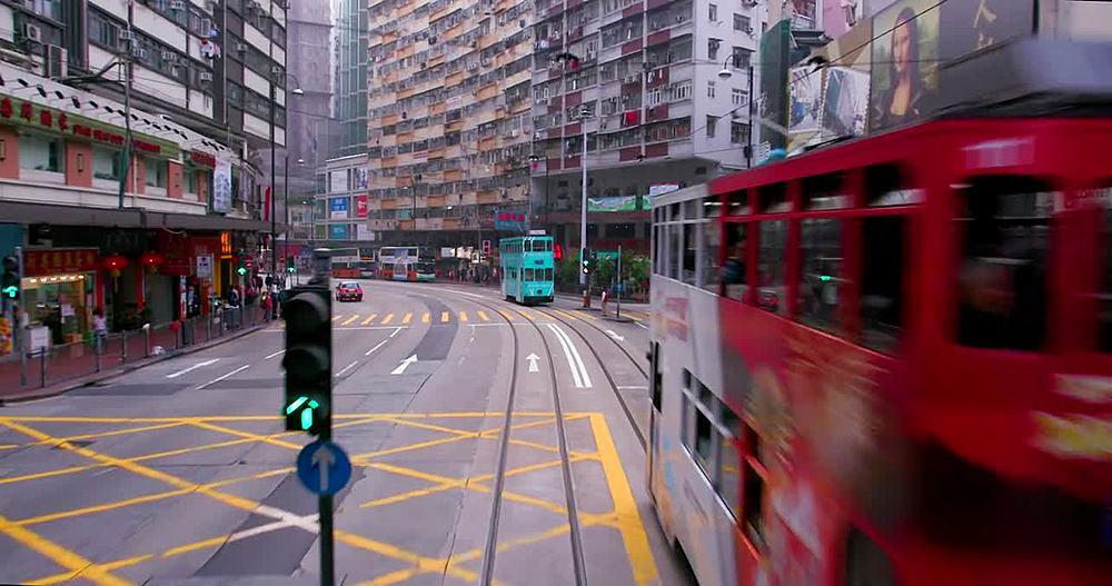 Riding on tram; North Point, Hong Kong, China
