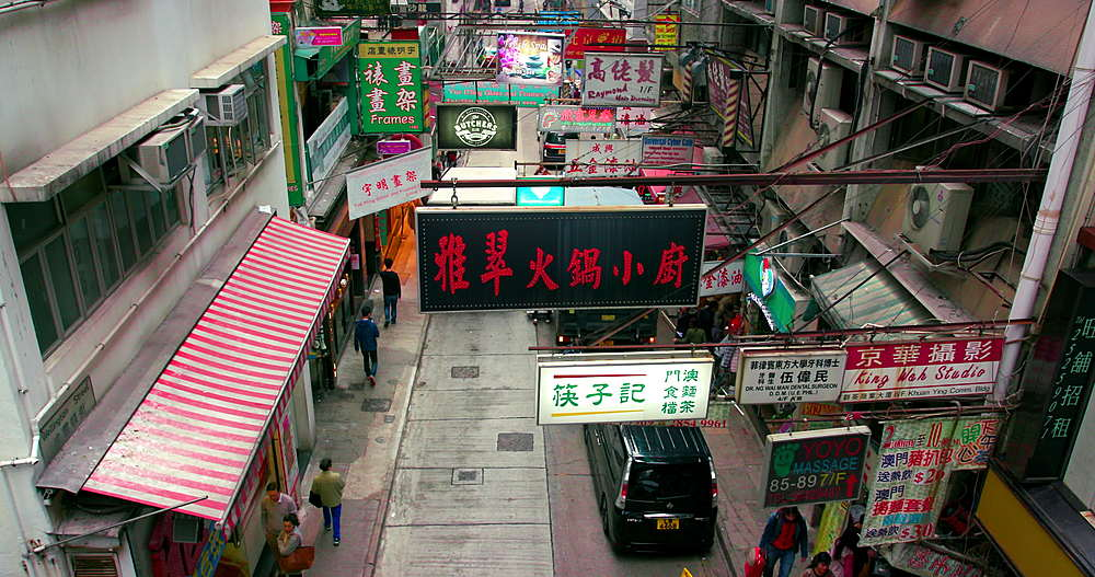 Looking down on neon signs & pedestrians, Stanley street, central, Hong Kong, China
