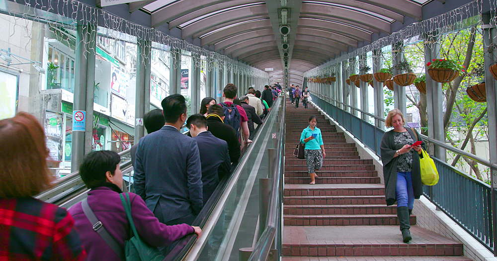 Pedestrians on the mid level escalators, central, Hong Kong, China