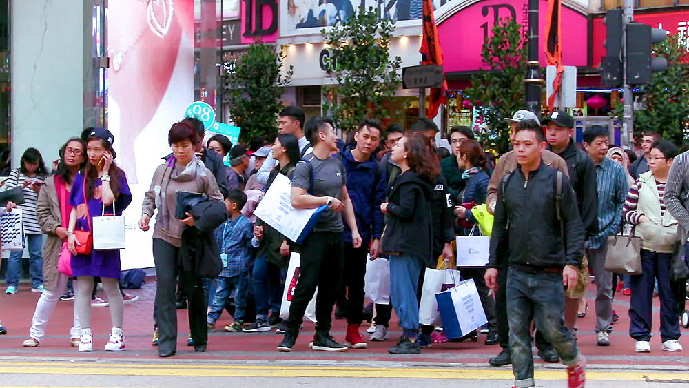 Pedestrians cross Yee Wo street & Hennessy road, Causeway Bay, Hong Kong, China