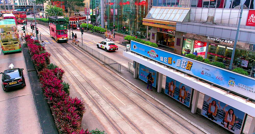 Trams & buses on Yee Wo street stop, Causeway Bay, Hong Kong, China