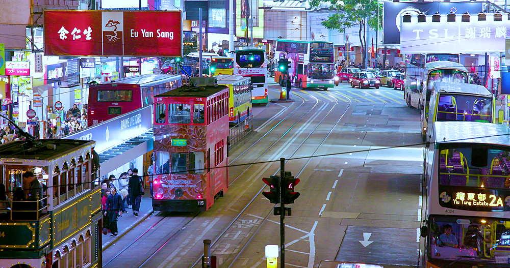 Trams & buses on Yee Wo street, Causeway Bay, Hong Kong, China