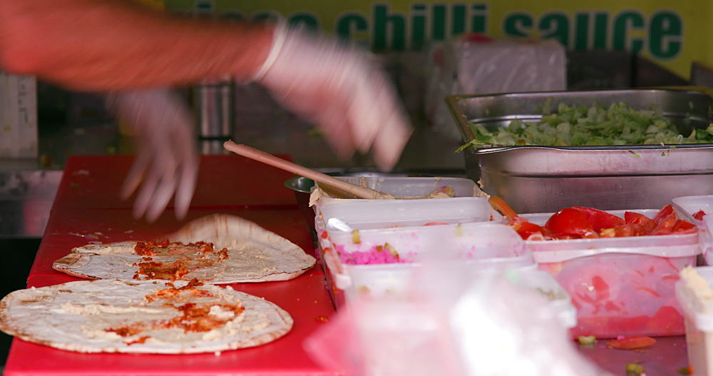 Street food wrap preparation, Wentworth street, London, England - 1130-5303