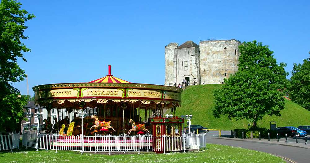 Cliffords tower & fairground carousel, york city centre, York, North Yorkshire, United Kingdom - 1130-6462