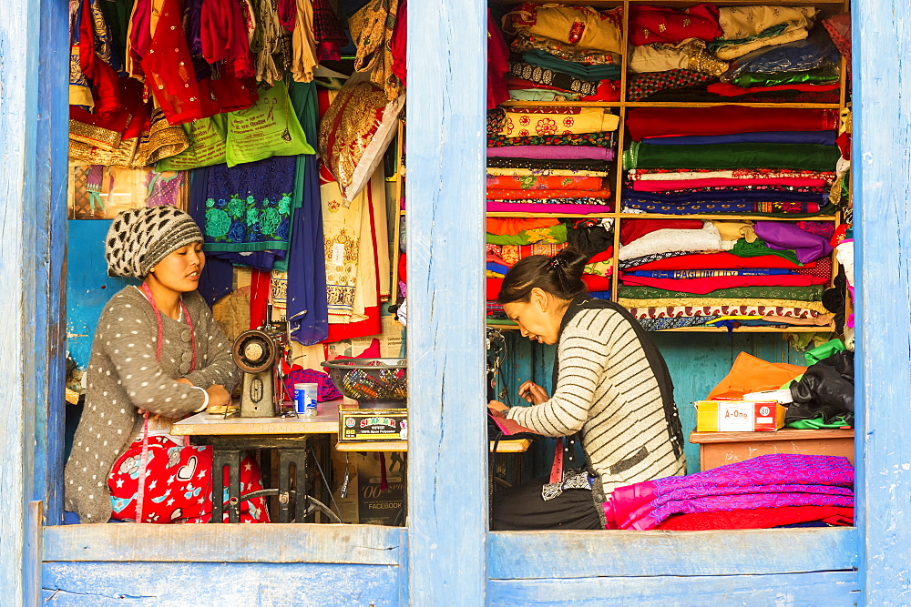 Young Nepalese women working in an open Tailor shop in Bandipur, Tanahun district, Nepal, Asia - 1131-1033