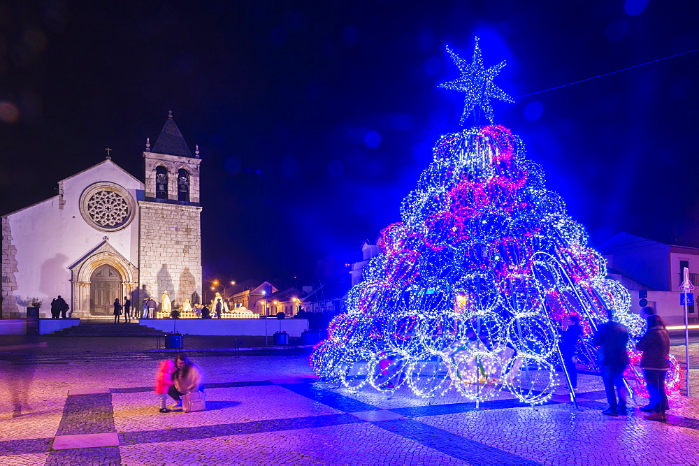 Illuminated modern Christmas tree in front of the Parish Church, Alcochete, Setubal Province, Portugal