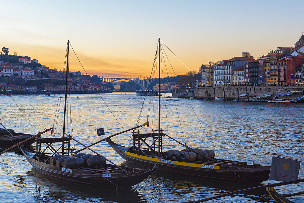 Sunset over Ribeira district and the River Douro with Rabelos, UNESCO World Heritage Site, Oporto (Porto), Portugal, Europe