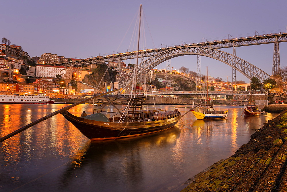 Sunset over Ribeira district, the Douro, Rabelos and Ponte Dom Luis I Bridge, UNESCO World Heritage Site, Oporto (Porto), Portugal, Europe