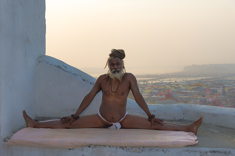 Rome Baba practising yoga, For Editorial Use Only, Allahabad Kumbh Mela, Largest religious gathering, Uttar Pradesh, India