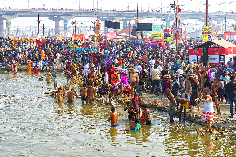 Pilgrims waiting to enter the Ganges river for the ritual bathing, Allahabad Kumbh Mela, Uttar Pradesh, India