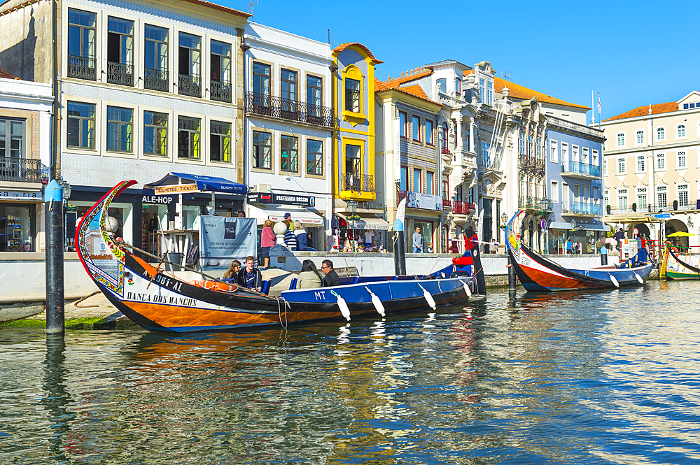 Moliceiros moored along the main canal. Aveiro, Venice of Portugal, Beira Littoral, Portugal
