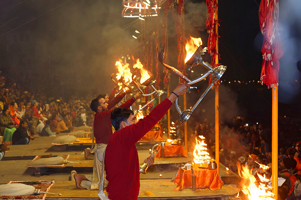 Priest celebrating the river Ganges Aarti by offering incense, Dashashwamedh Ghat, Varanasi, Uttar Pradesh, India - 1131-1314