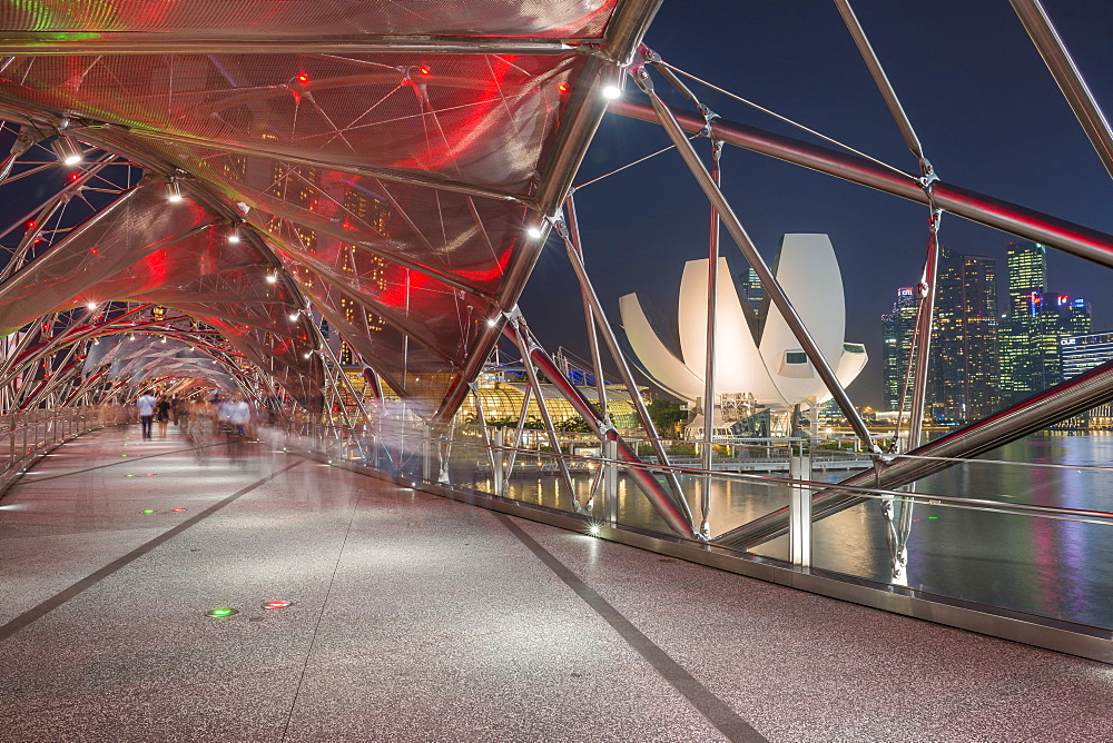 Double Helix Bridge and Art and Science Museum and downtown central financial district at night, Singapore, Southeast Asia, Asia