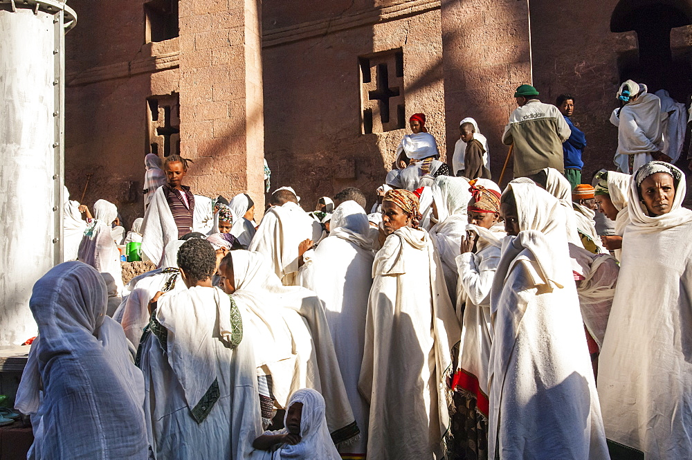 Pilgrims with the traditional white shawl attending a ceremony at the Bete Medhane Alem Church, Lalibela, Amhara region, Northern Ethiopia, Africa