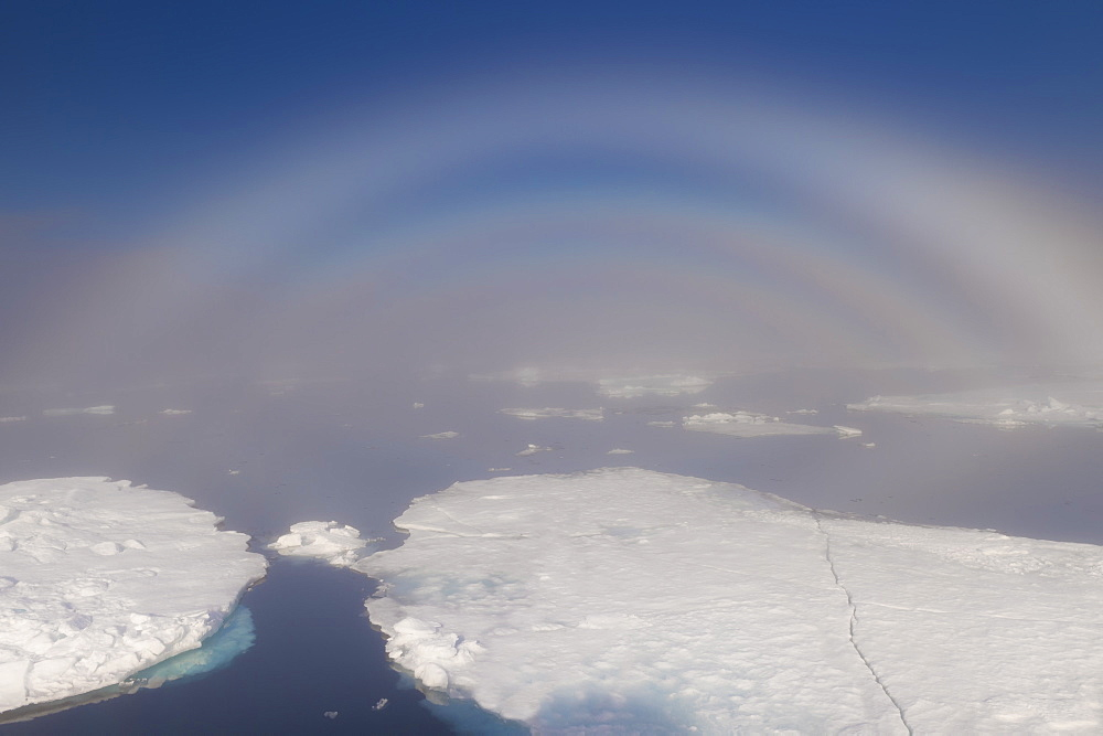 White rainbow over the ice, Arctic Ocean, Arctic, Norway, Scandinavia, Europe