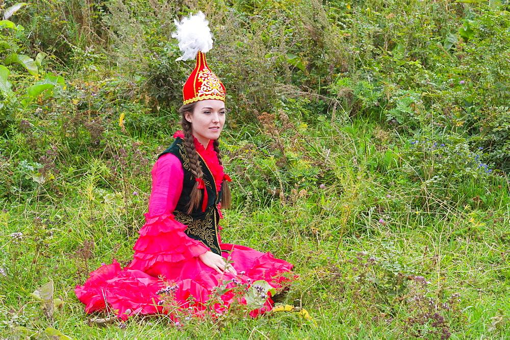 Young Kazakh woman, Kazakh ethnographical village Aul Gunny, Talgar city, Almaty, Kazakhstan, Central Asia, For editorial Use on