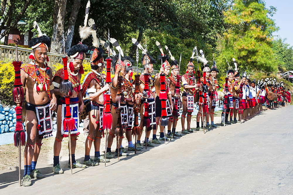 Naga tribal group performers standing in line to welcome the Officials at the Hornbill Festival, Kohima, Nagaland, India