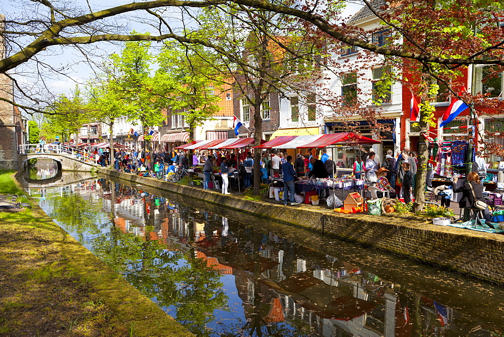 King's Day Flea Market along a canal, Delft, South Holland, Netherlands, Europe
