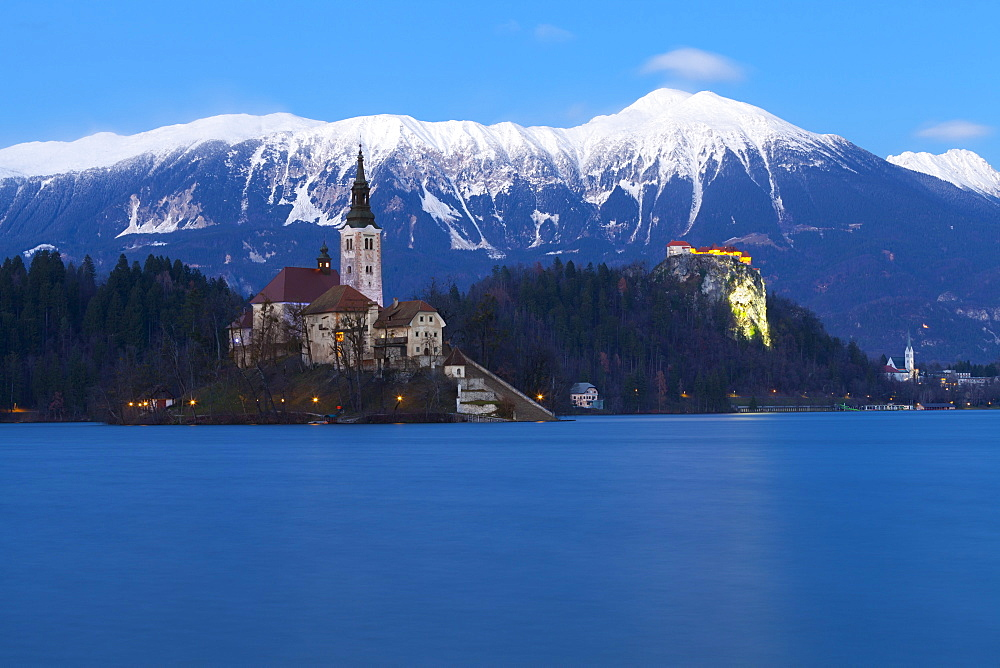 The Assumption of Mary Pilgrimage Church on Lake Bled and Bled Castle at Dusk, Bled, Slovenia, Europe